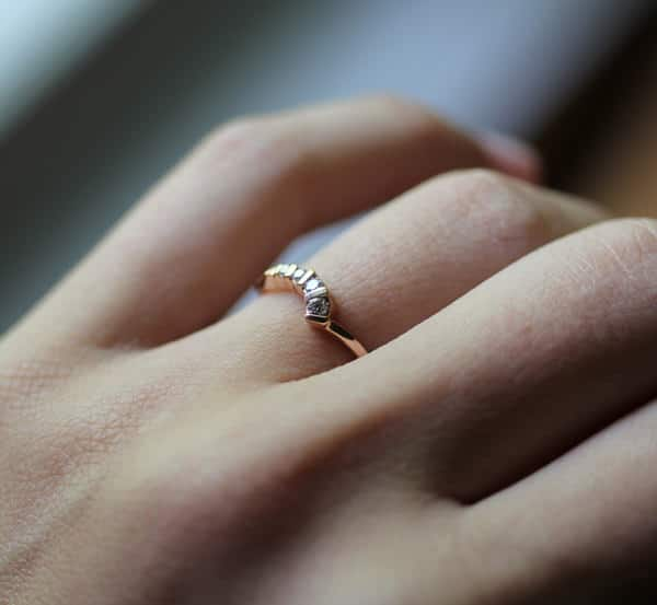 picture of a diamond engagement ring on her finger