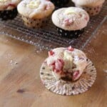 strawberries and cream cheese muffins on wire rack