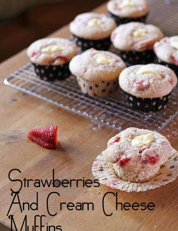rows of strawberries and cream cheese muffins on wire rack