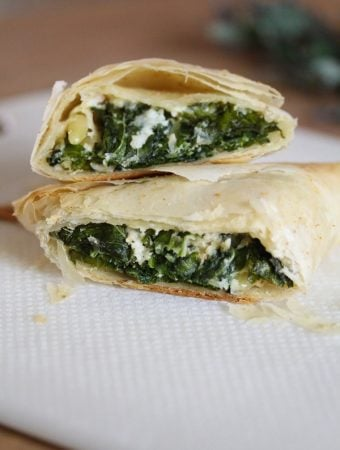 two kale spanakopitas cut in half