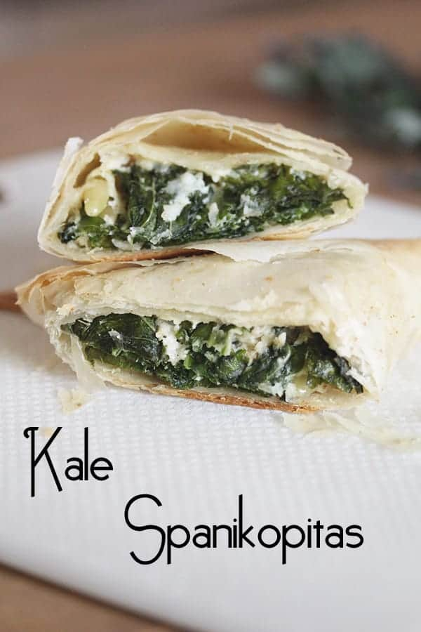 Kale Spanakopitas stacked on a white plate