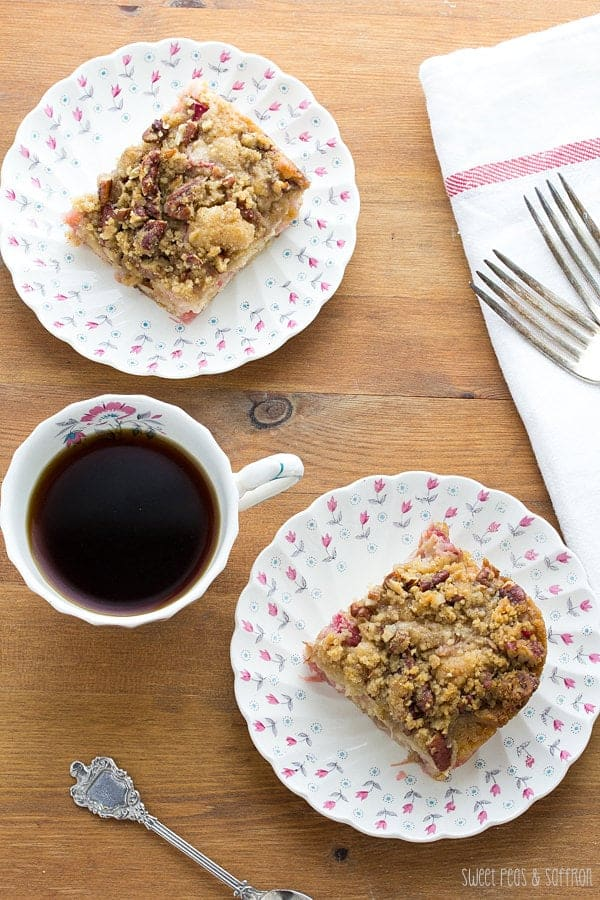 Overhead view of Rhubarb Buttermilk Coffee Cake on plates with forks and a cup of coffee