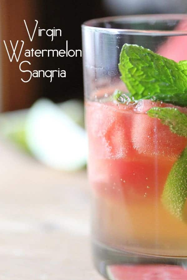 Virgin Watermelon Sangria in a glass with fresh mint sprig