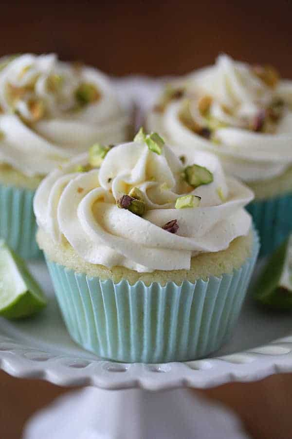 Close up shot of Key Lime Cupcakes with White Chocolate Frosting and Pistachios