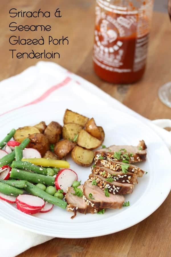 Glazed Pork Tenderloin sliced on plate with roasted potatoes and fresh vegetables