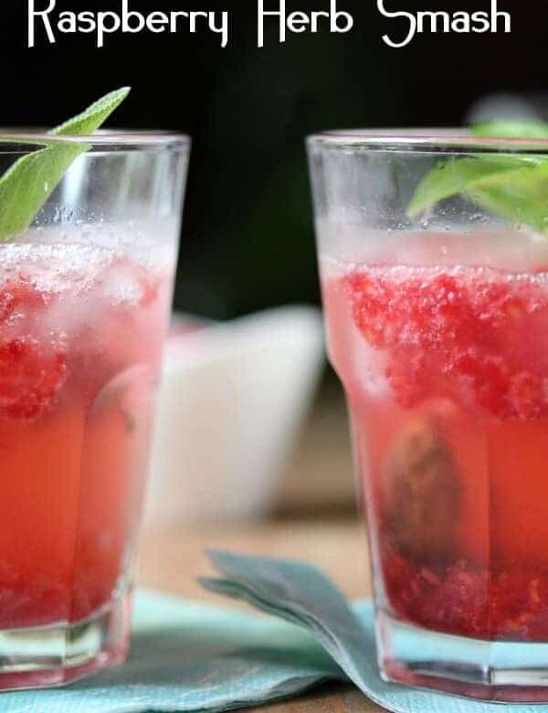 two raspberry smash cocktails on blue napkin