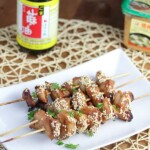 three miso and sesame grilled chicken kebabs on white tray