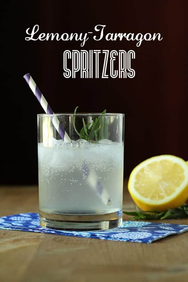 Lemon Tarragon Spritzer in a glass with striped straw and half a lemon