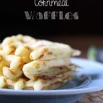 zucchini cheddar and cornmeal waffles on blue plate