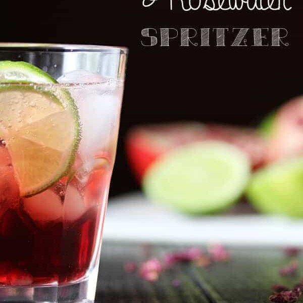 side view of pomegranate rosewater spritzer in glass