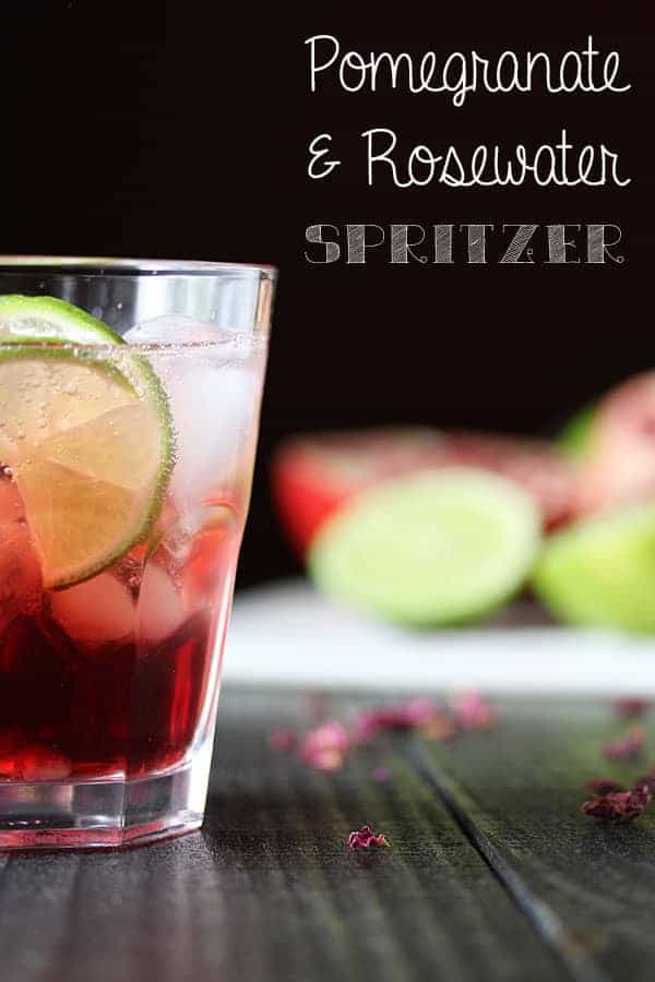 Pomegranate and Rosewater Spritzer in a glass with fresh lime slice