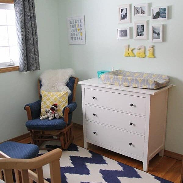 Kai's nursery with crib and blue and white furniture