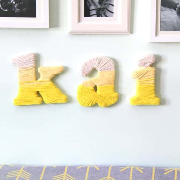 DIY Yarn Wrapped Letters spelling kai hung on the wall