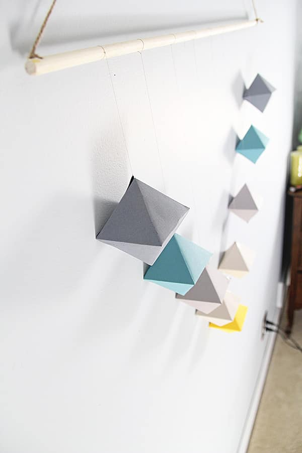 Close up view of the Geometric Paper Wall Hanging on white wall