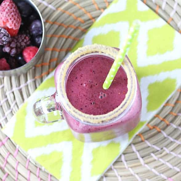 Overhead view of Triple Berry Pie Smoothie in a mason jar with a straw