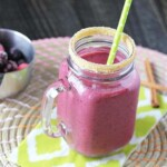 triple berry pie smoothie in mason jar with green straw