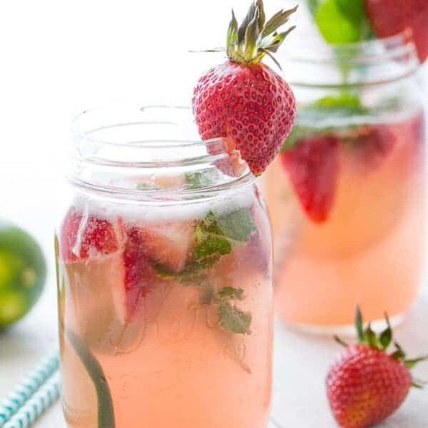 two glass mason jars with strawberry rhubarb rose sangria