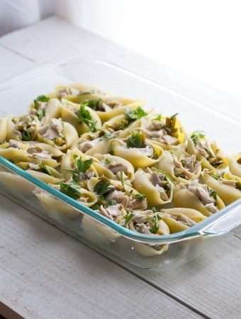 cheesy jalapeno and chicken stuffed pasta shells in glass container