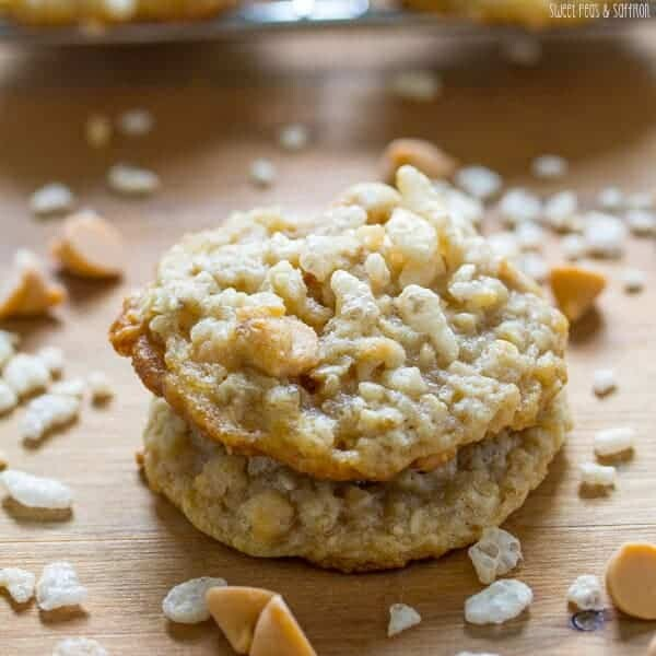 stack of two butterscotch oatmeal rice krispie cookies on wood board