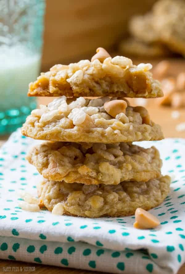 Stack of four Rice Krispie Cookies with butterscotch chips on a blue and white napkin