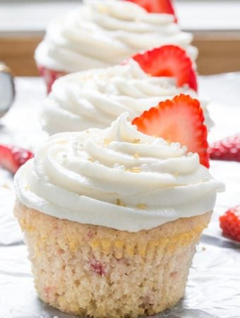 three strawberry cupcakes with chapagne frosting
