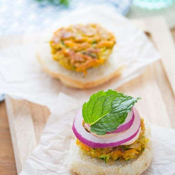 open face mini moroccan chickpea burgers with spicy harissa mayo on parchment