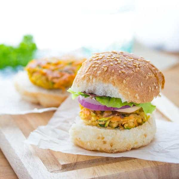 Mini Moroccan Chickpea Burgers on parchment paper and cutting board