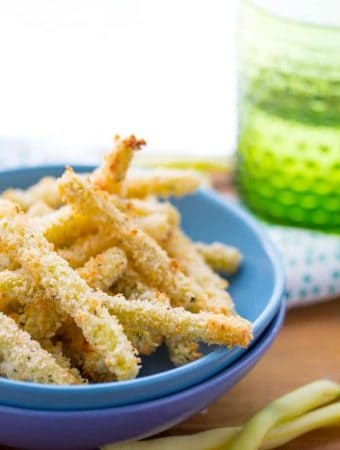crispy parmesan baked green bean fries in blue bowl
