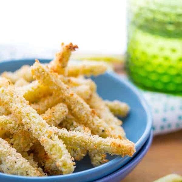 crispy parmesan baked green bean fries in blue bowl