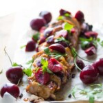 chipotle grilled pork tenderloin with fresh cherry salsa on parchment