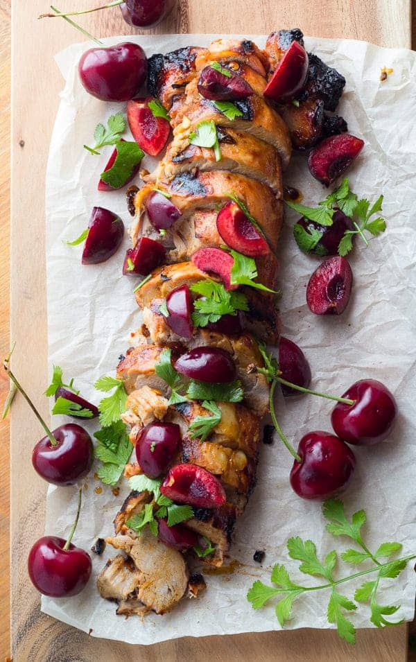 Chipotle Grilled Pork Tenderloin on parchment paper with Fresh Cherry Salsa
