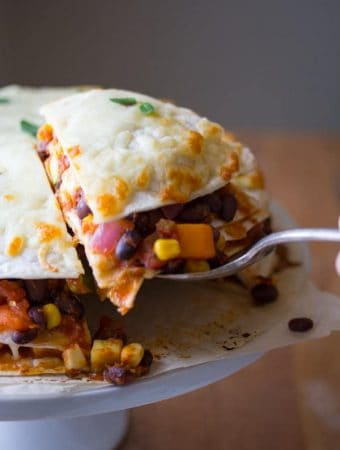 garden vegetable black bean tortilla stack with fork taking a bite