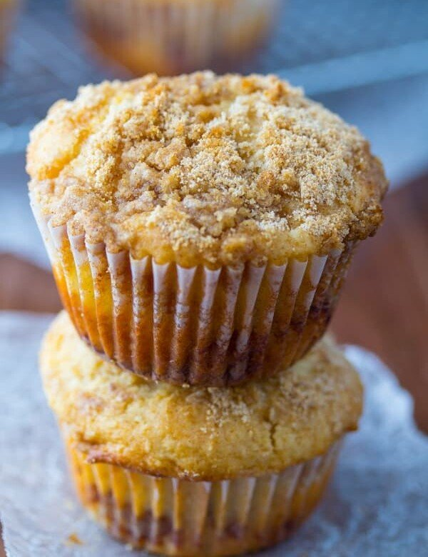 stack of two apple coffee cake muffins on parchment