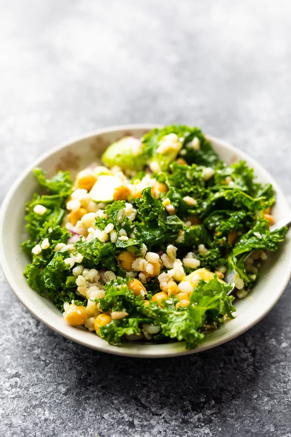 kale barley salad in bowl after tossing