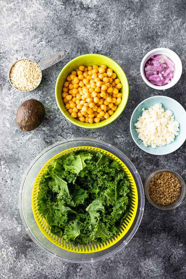 overhead view of ingredients required for kale and chickpea barley salad