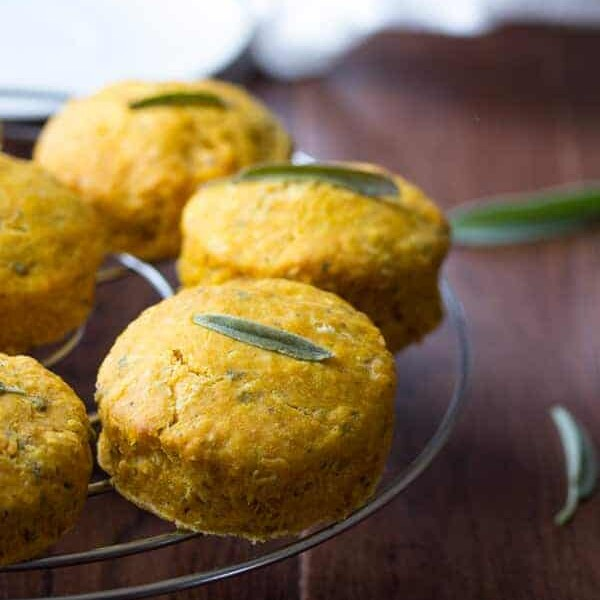 five pumpkin biscuits with sage on wire rack