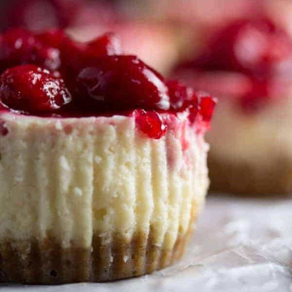 side view of leftover cranberry sauce mini cheesecake on parchment