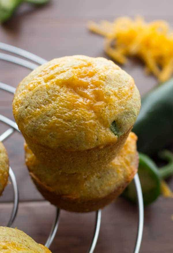 Stack of two Jalapeño Popper Cornbread Muffins on wire rack