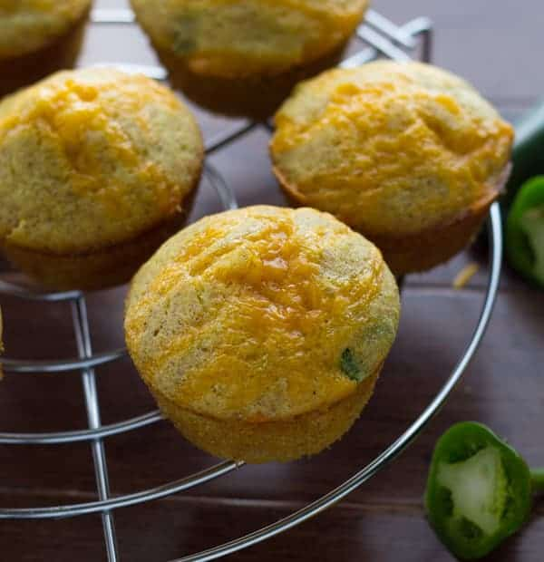 Four Jalapeño Popper Cornbread Muffins cooling on wire rack