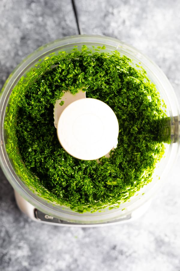 overhead view of kale pesto in food processor (after)