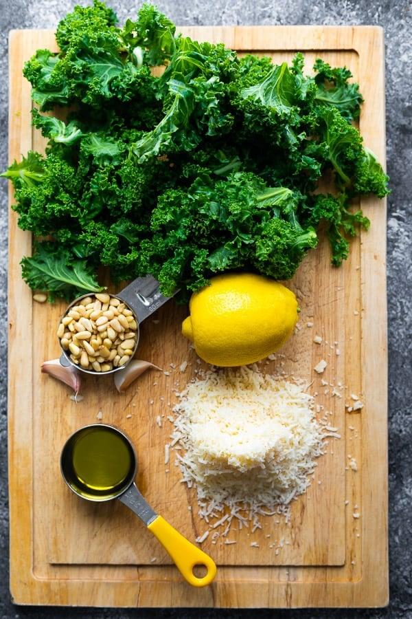 ingredients for kale pesto recipe on cutting board