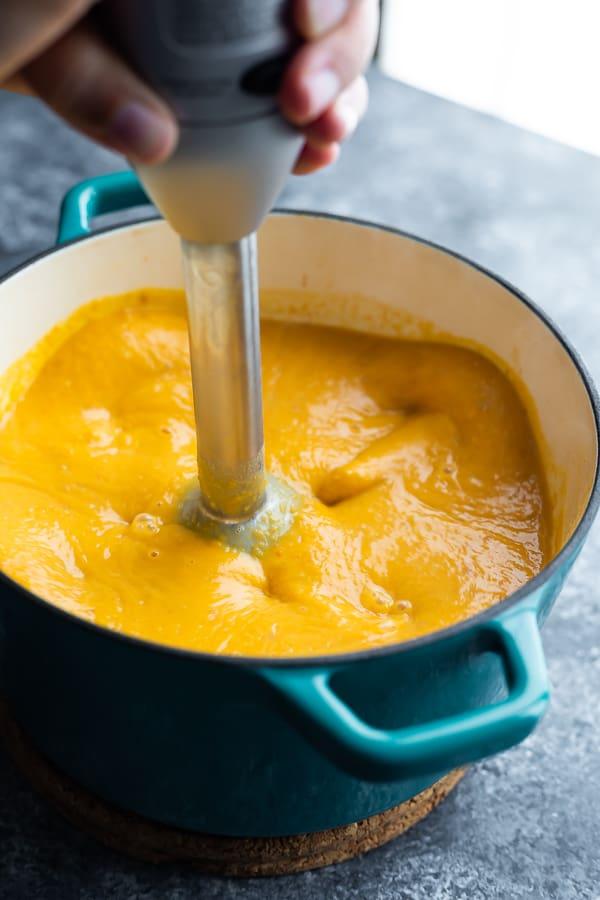 immersion blender blending orange soup