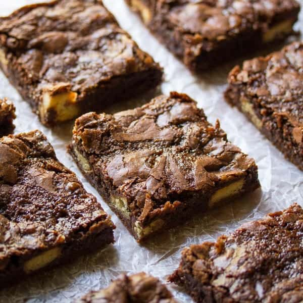 Salted Caramel Brownies in rows on parchment paper after baking