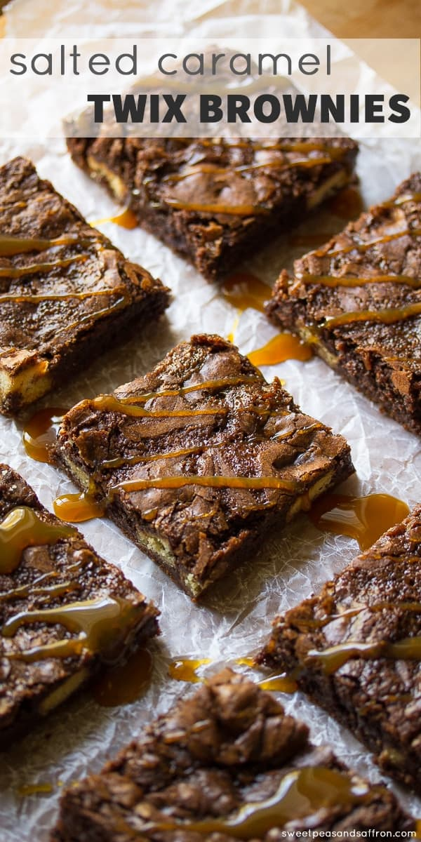 Salted Caramel Twix Brownies in rows on baking sheet with caramel drizzle