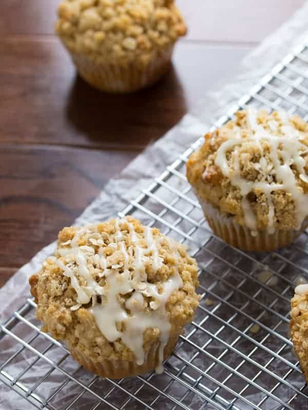 Glazed Maple Walnut Oatmeal Muffins on wire rack with icing drizzle