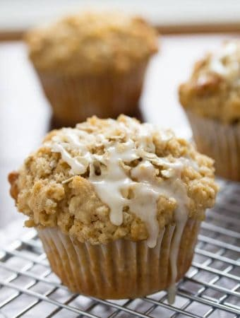 close up shot of glazed maple walnut oatmeal muffins on wire rack