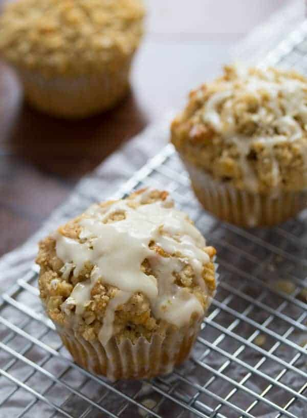 Close up picture of single Glazed Maple Walnut Oatmeal Muffin on wire rack