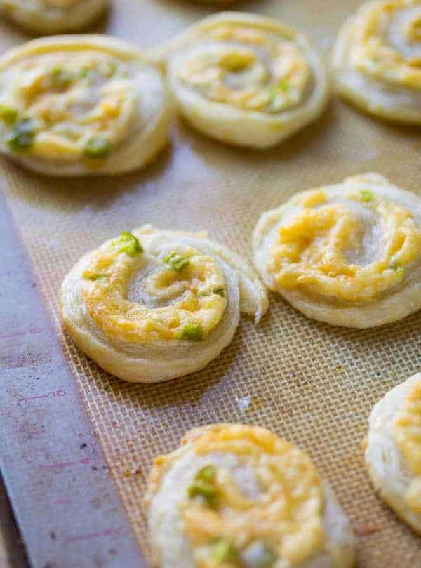Smoked Gouda Puff Pastry Pinwheel Appetizers on silicone baking mat