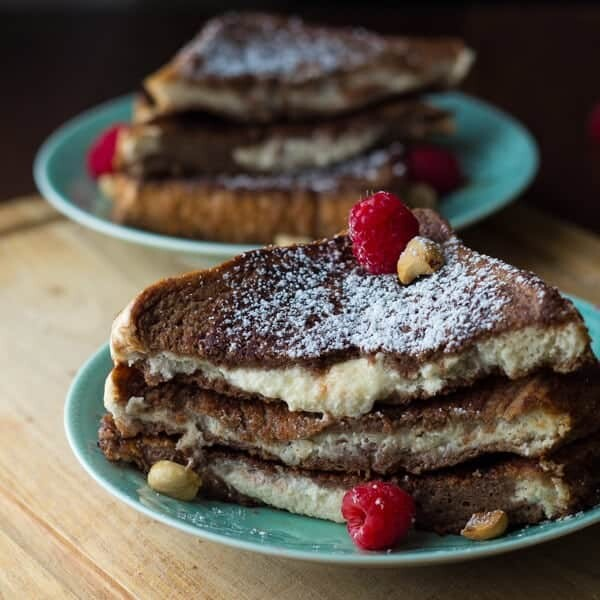 mascarpone stuffed french toast stacked on two blue plates