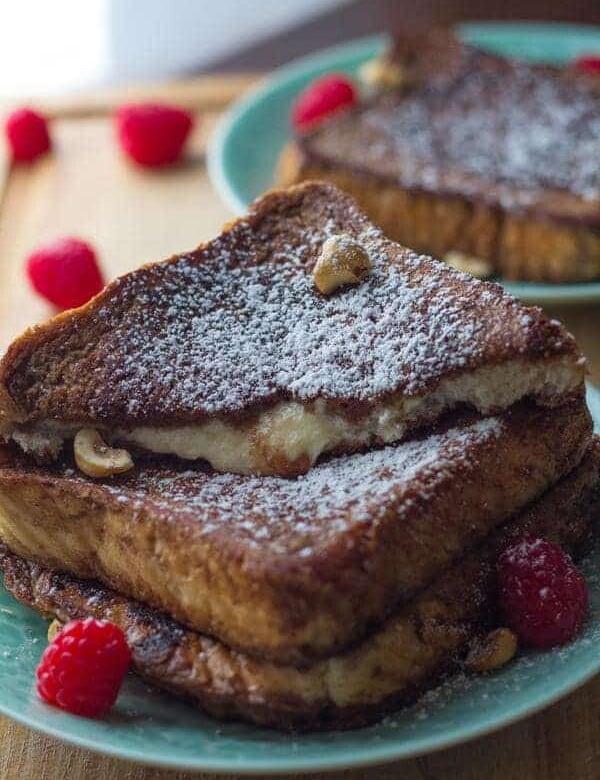 close up shot of mascarpone stuffed french toast with fresh raspberries